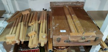 A portable artists easel & four similar smaller easels
