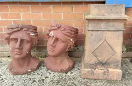 A chimney pot and two large resin planters in the form of heads