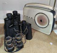Three sets of binoculars and a vintage Bush radio