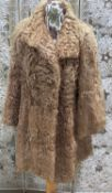 A honey / beige flat wavy fur jacket, medium