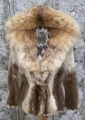 A late 20th century fur coat with drawstring waist and fur lined hood, M
