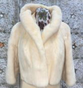 A short cream mink cocktail mink jacket with three quarter length sleeves and raised collar, Medium