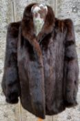 A c1970's brown mink jacket with tight cuffs, stand up collar, size 14, by Barry Whitby; a mink