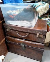 A Victorian tin trunk, a Vulcanide fibre suitcase, a selection of 1930's hand woven wool fabric