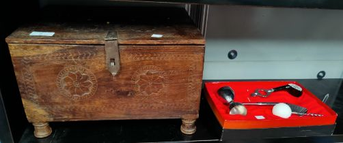 An Indian hardwood box with hinged lid, 35cm a slate top table 36cm and a golf themed jigger etc