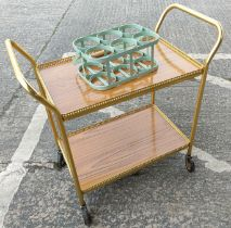 A retro style milk/bottle carrier (small bolt missing), a vintage gilt cocktail trolly
