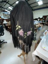 Two embroidered fringed black shawls in the Madeira style; 3 other shawls (some damage / holes0