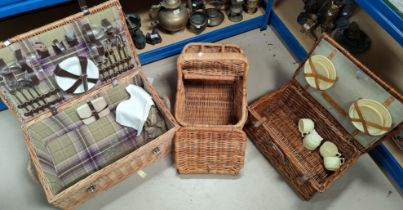 Three vintage picnic baskets, two part fitted with plates etc