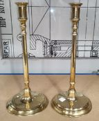 An oval 19th century copper kettle; a pair of slender column candlesticks; a tapering brass jug