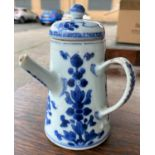 An 18th century Chinese blue and white lidded chocolate pot with floral decoration, height 14.5cm (