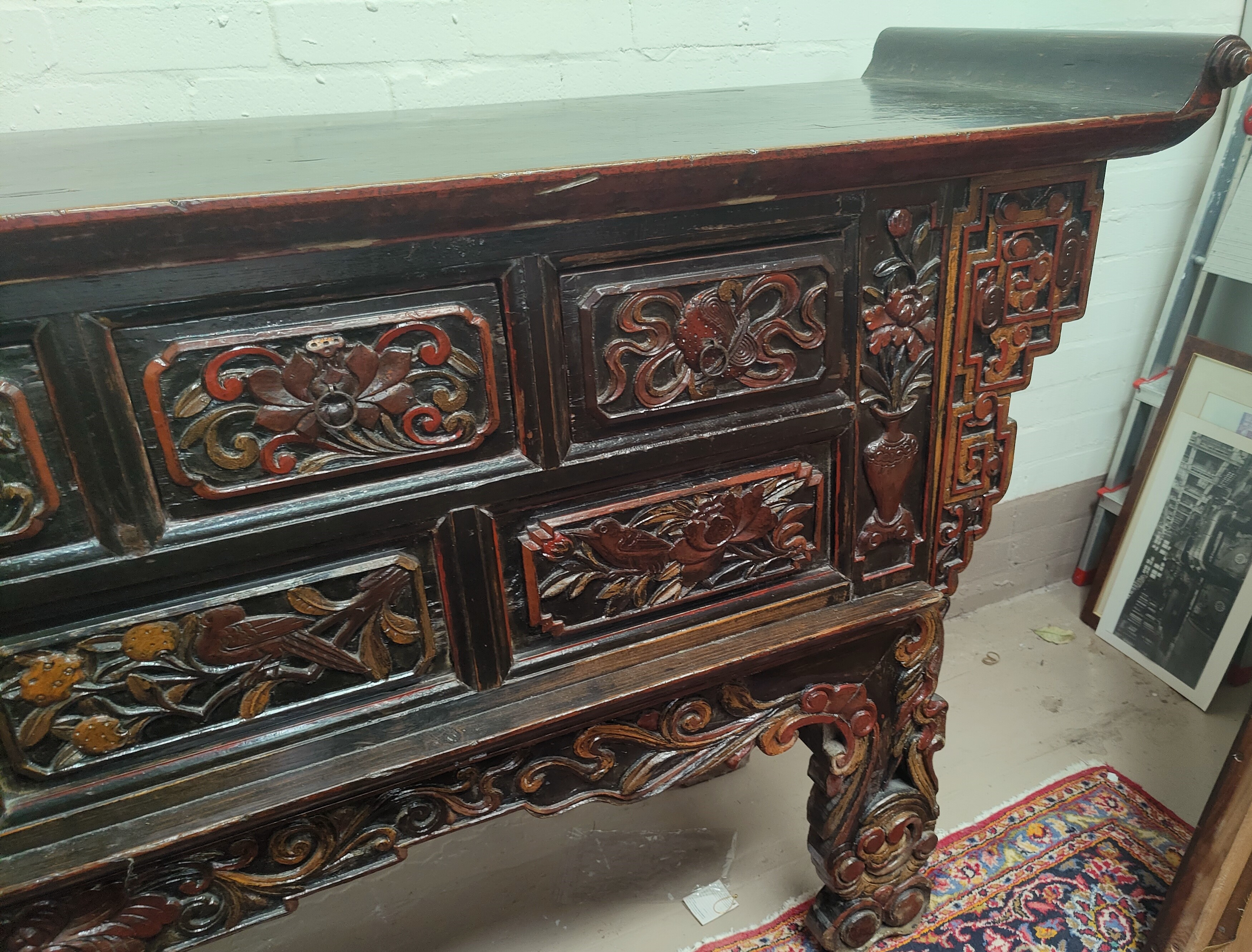 A late 19th/early 20th century Chinese unusual altar table, carved and lacquered with scroll end - Image 4 of 9