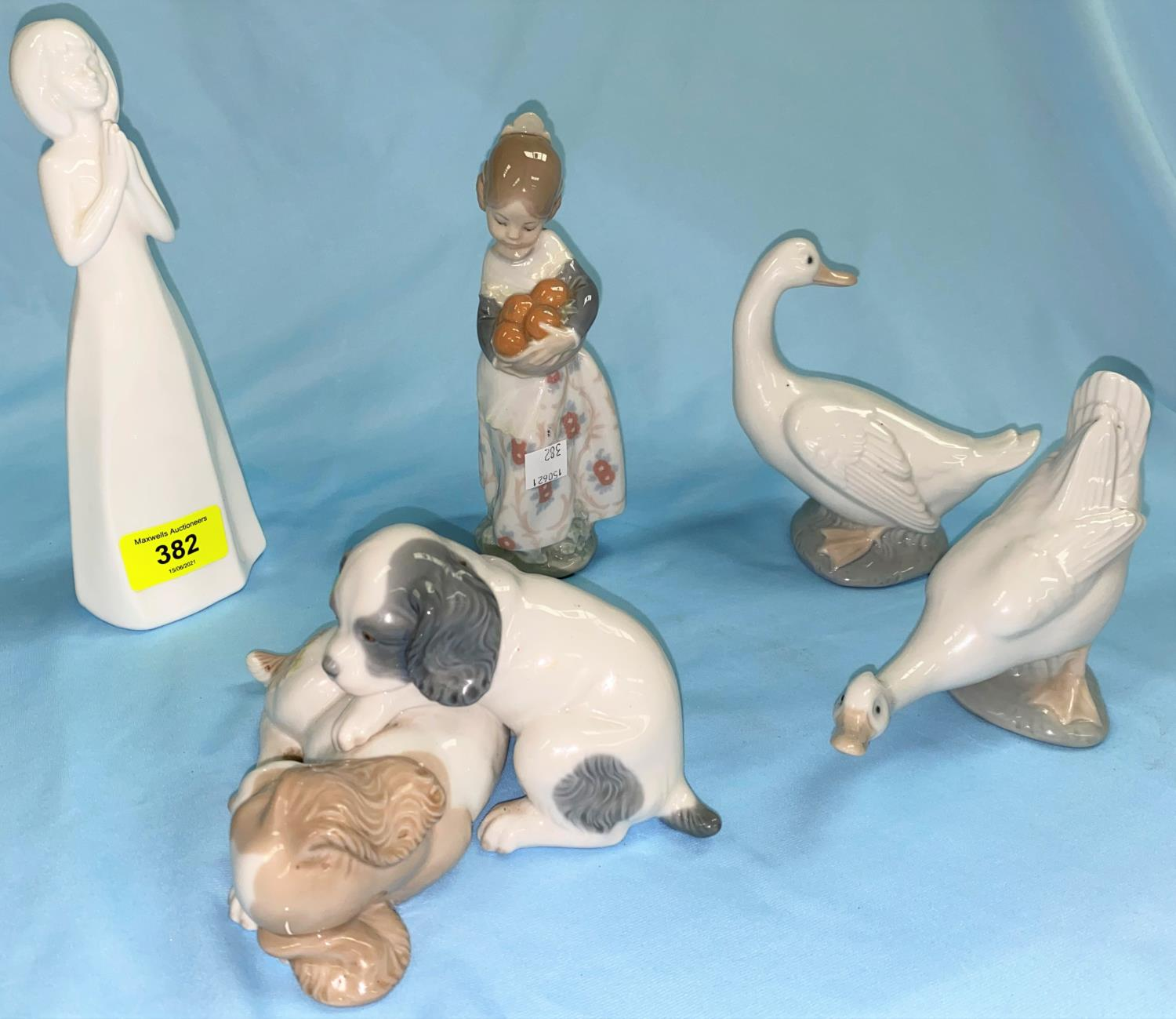 A Lladro figure of a Spanish girl with oranges; 4 Nao figures/animals