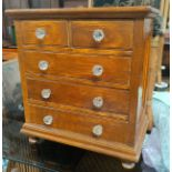 A Victorian miniature chest of drawers, scumbled finish, 44 x 26 x 49 cm