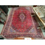 A mid 20th century Turkoman carpet, floral motifs on red ground multi-coloured, 9.5' x 12.5' approx