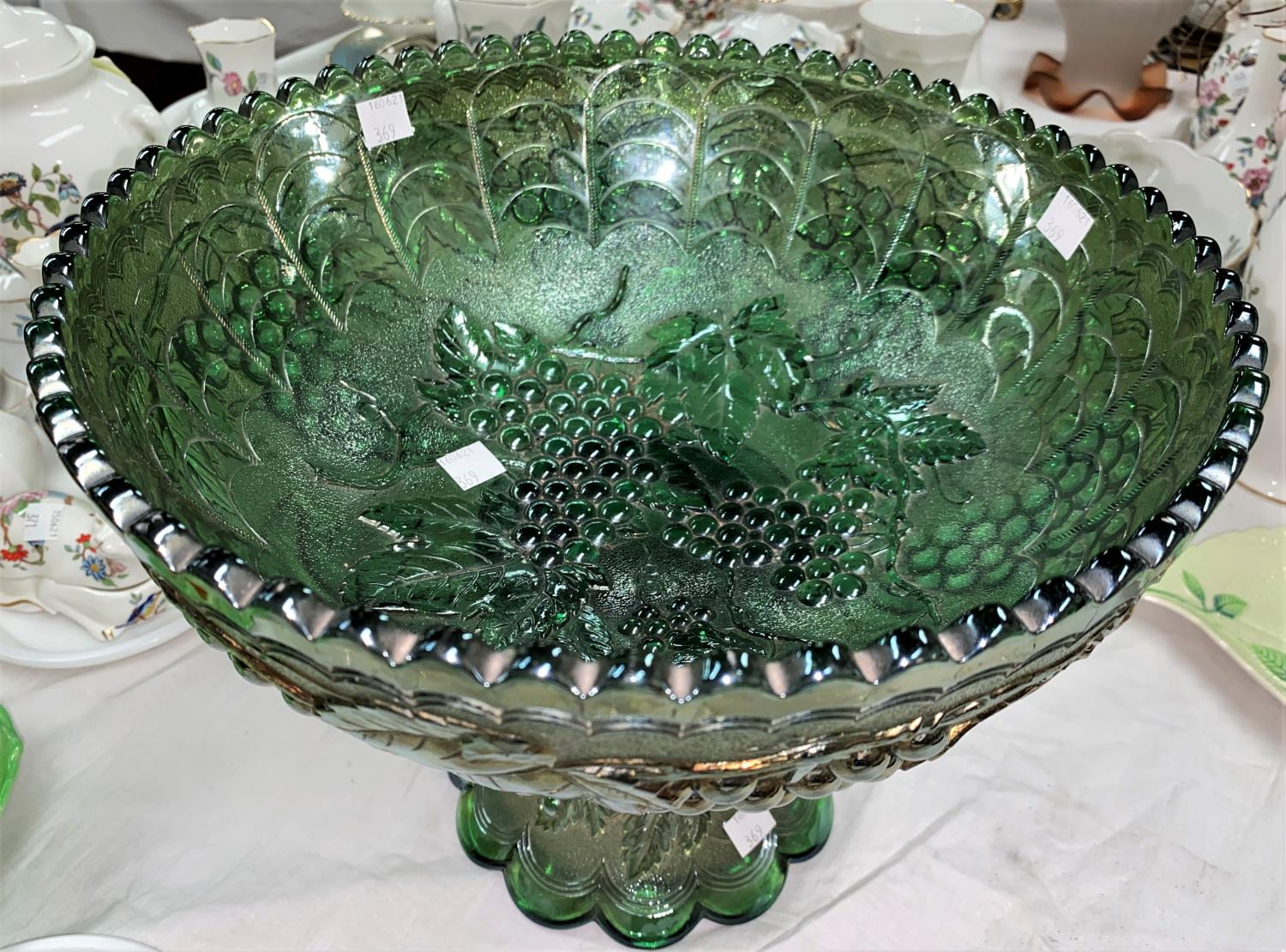 An impressive Carnival Glass table centre green fruit bowl, molded fruiting vine decoration, - Image 2 of 2