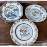 Three 18th / 19th century Chinese dishes with polychrome floral and animal decorations, diameter