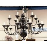 A large impressive modern bronze effect 18 branch chandelier, two tiers, on of 12 and one of 6,