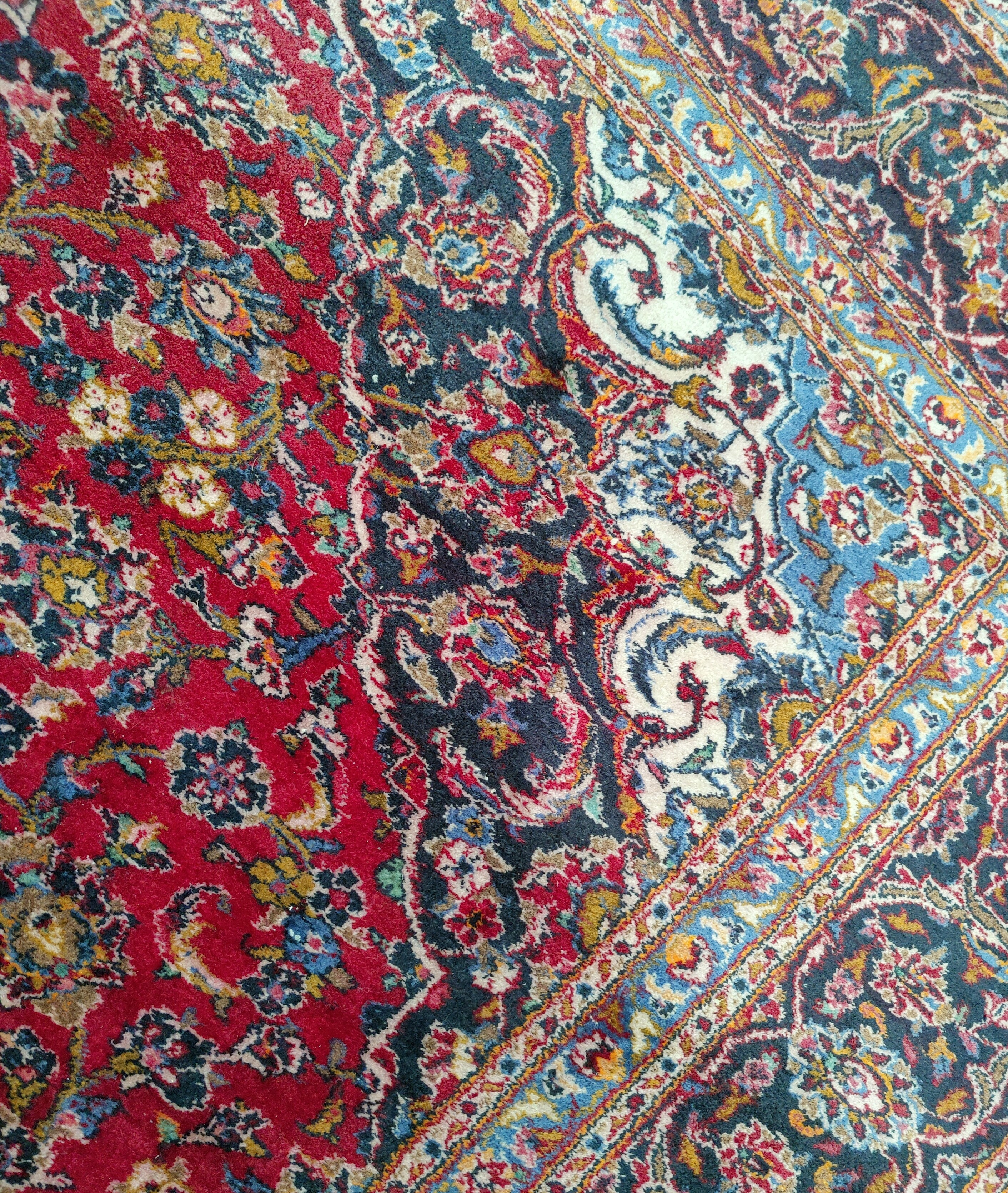 A mid 20th century Turkoman carpet, floral motifs on red ground multi-coloured, 9.5' x 12.5' approx - Image 4 of 4