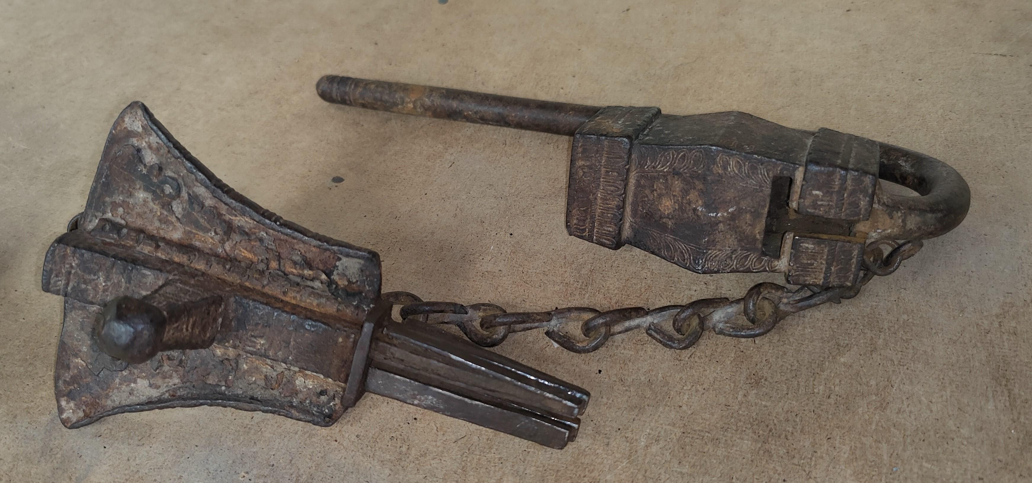 An 18th century Tibetan cast iron temple lock and key