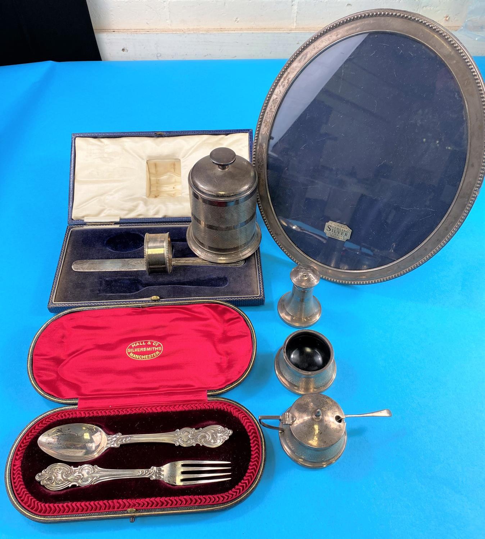 A hallmarked silver oval photo frame, an Art Deco hallmarked silver and Bakelite cigarette holder,