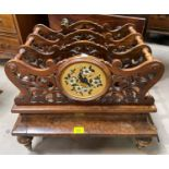 A Victorian figured walnut Canterbury of 3 divisions in fretwork with painted gilded panels and base