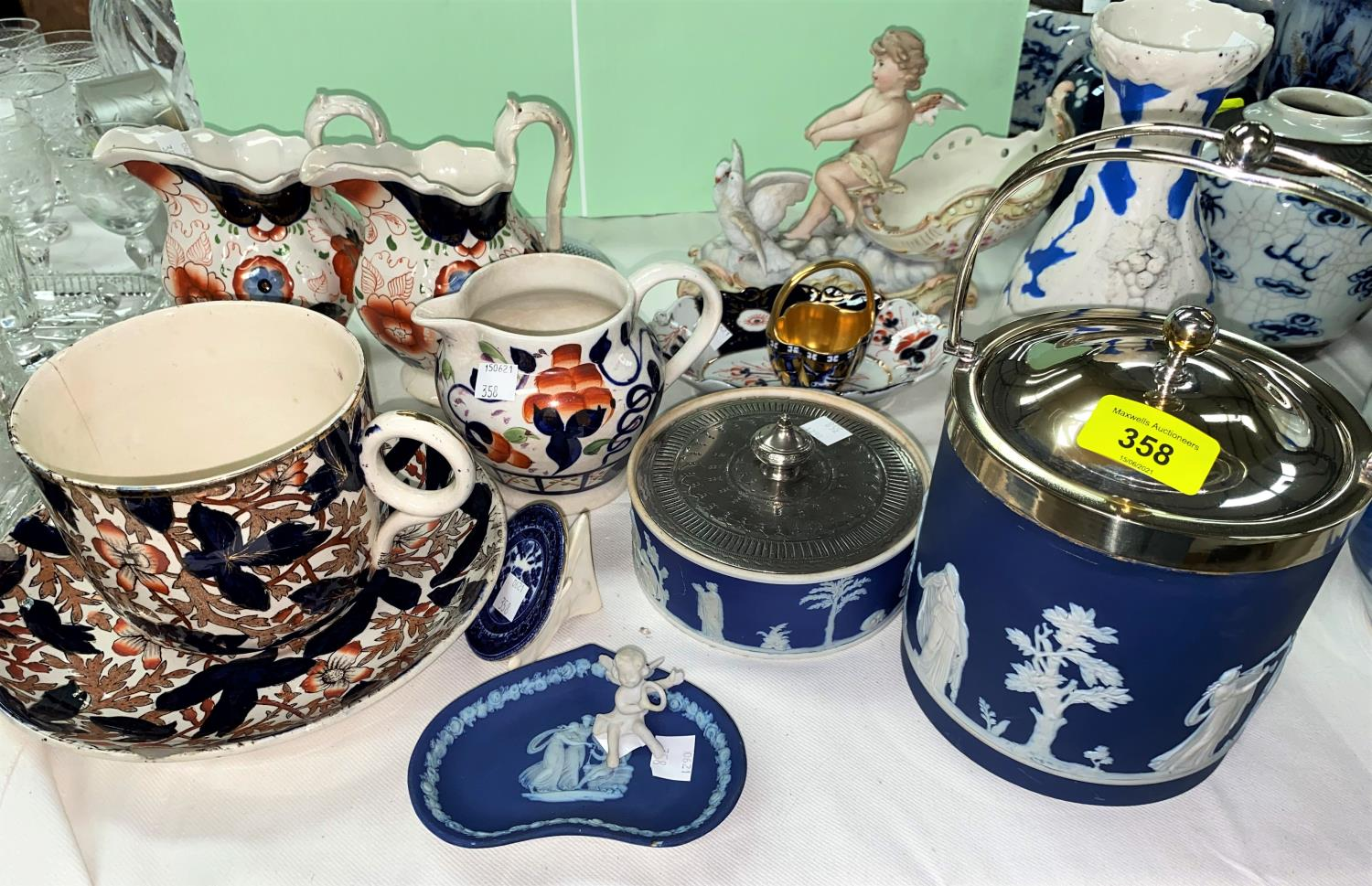 An Adams blue jasperware biscuit barrel with silver plated mounts, 16 cm; other similar pieces