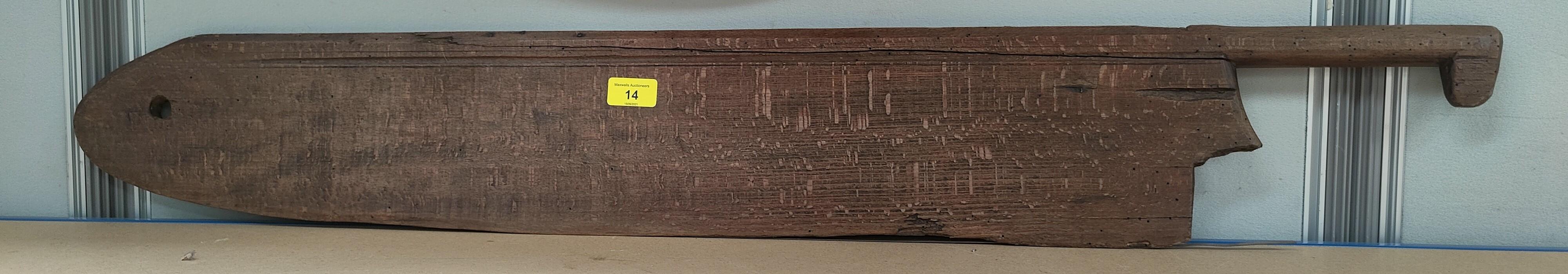 An antique wooden farmer's wheat shearing tool