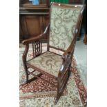 An Edwardian mahogany rocking chair, inlaid stringing decoration