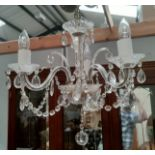 An antique crystal chandelier of 3 branches
