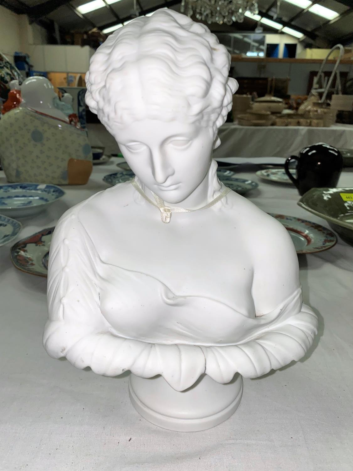 """A late 19th century Parian bust """"Clytie"""" probably Copeland, impressed """"202"""" height 29cm, (firing"""