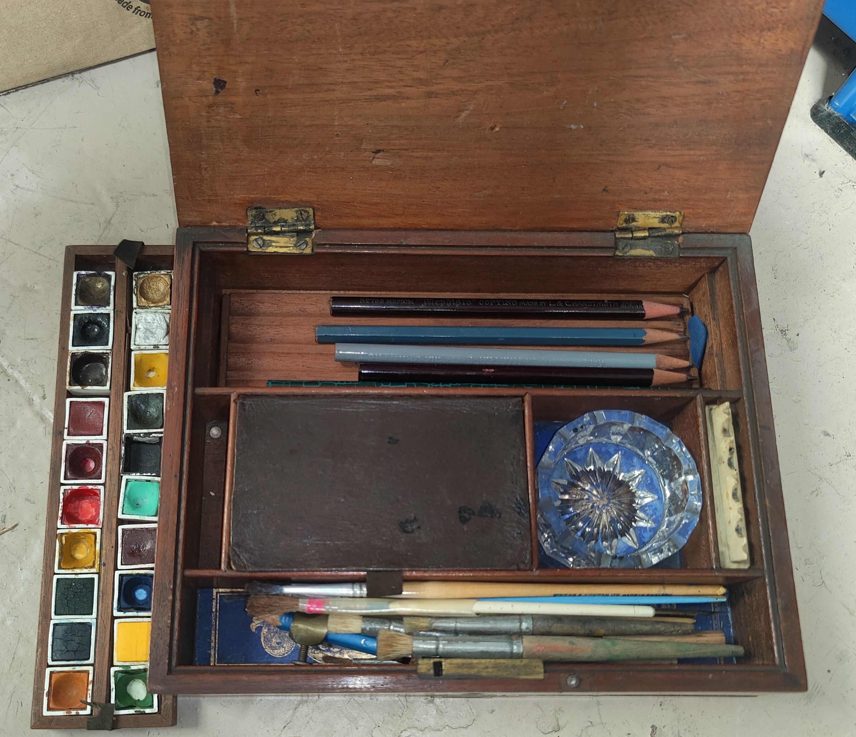 A 19th century artist's mahogany colour box, the ceramic palette marked Winsor and Newton, 23 cm
