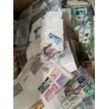 A selection of World stamps loose and on leaves