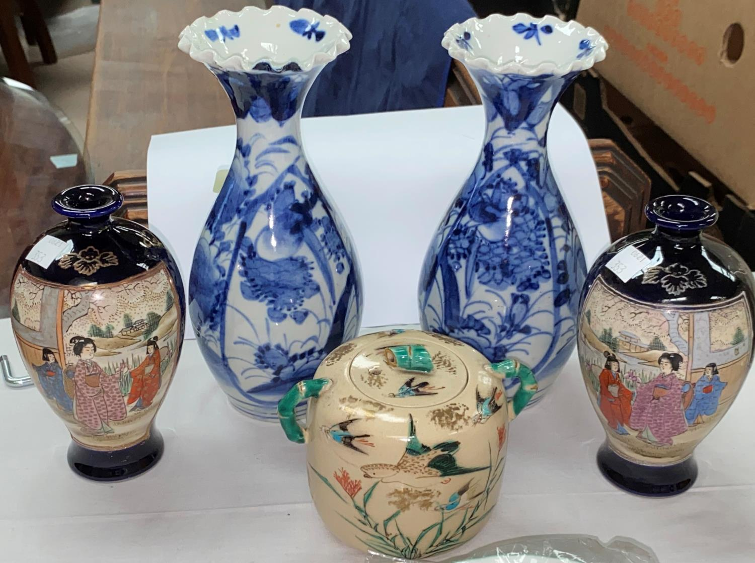 A Japanese pair of Imari vases, 21 cm; a pair of satsuma vases, 15 cm; another piece