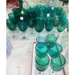A Victorian turquoise glass wine jug; 35 approx similar wines