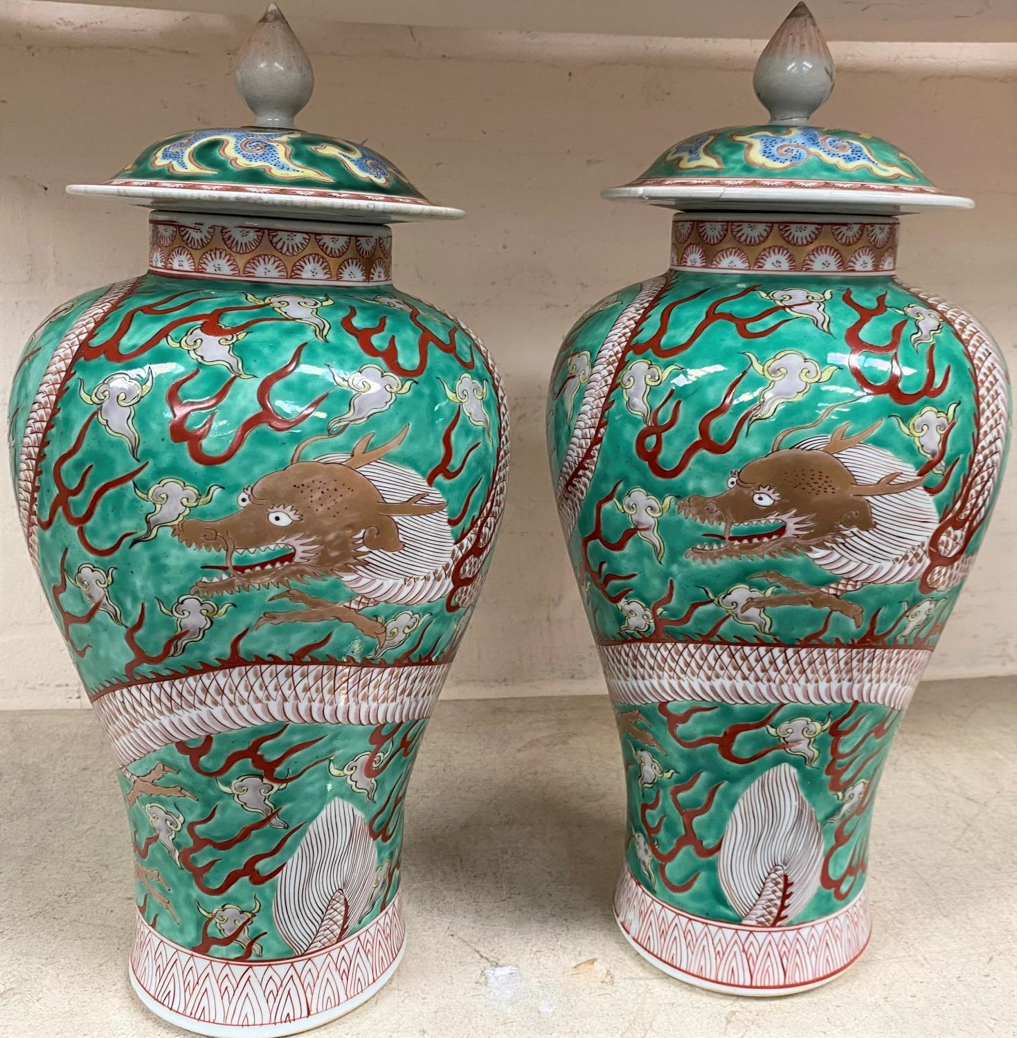 A pair of Chinese green ground lidded baluster vases with dragon decoration lids bearing marks, - Image 3 of 11