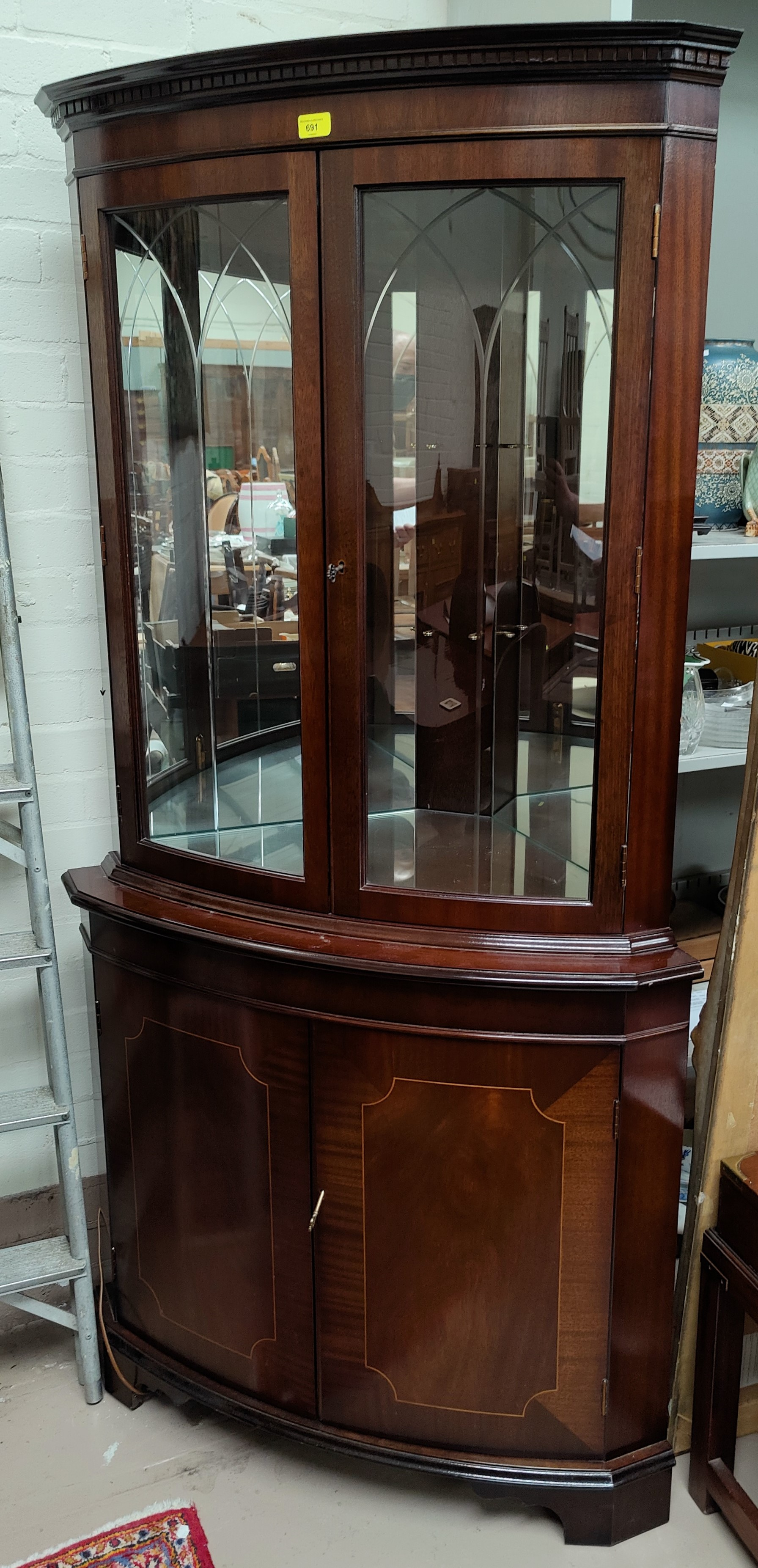 A reproduction mahogany full height corner cupboard with glazed cupboard above with mirror back