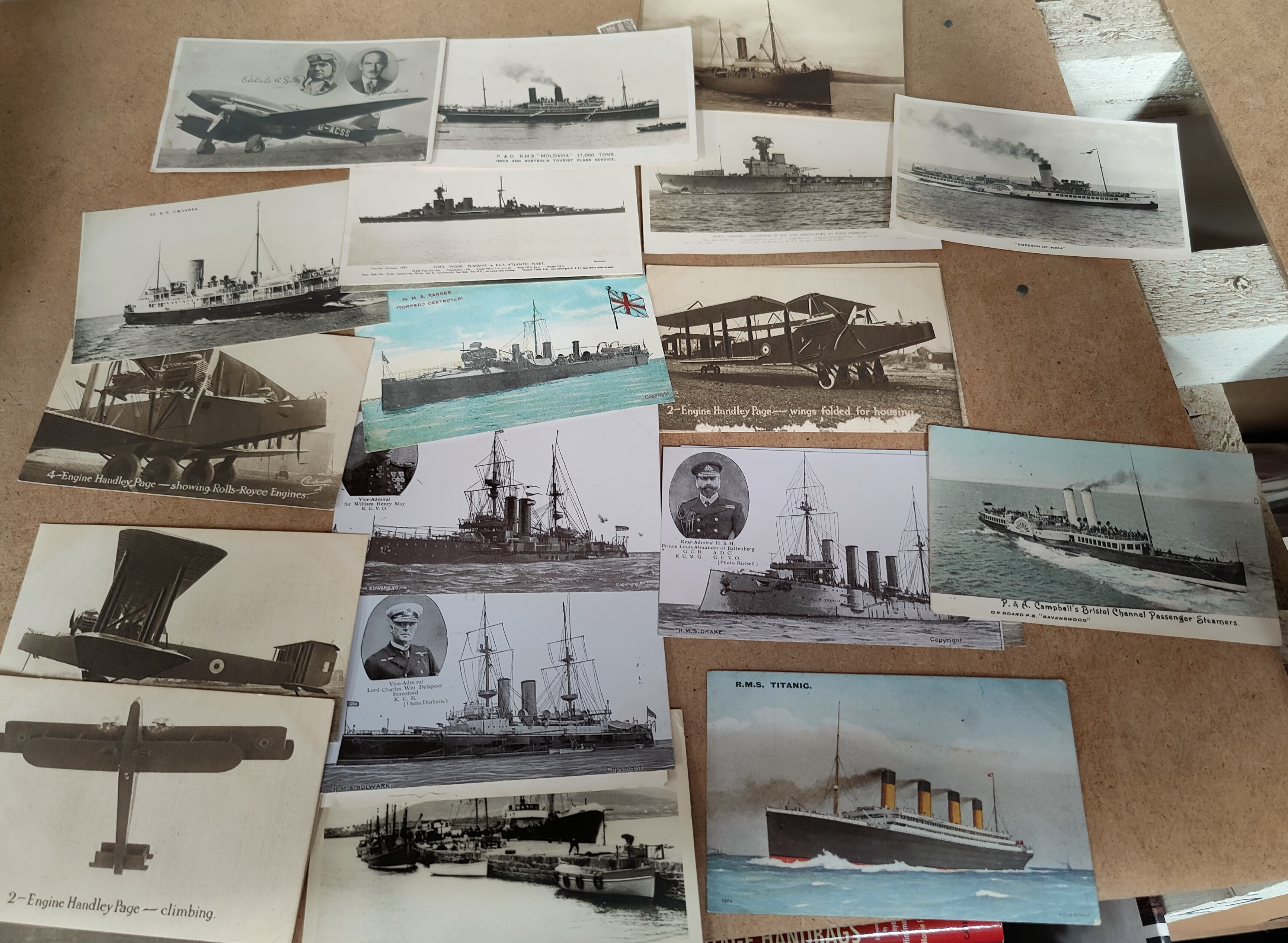 An RMS Titanic memorial postcard, other ships and 5 cards depicting Handley Page aircraft