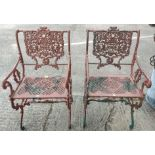 A pair of Victorian style unusual cast metal garden arm chairs