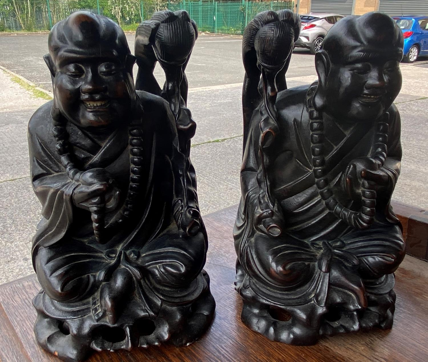 Two Chinese carved hardwood figures of seated sages height 25cm