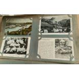 An Edwardian postcard album containing over 250 cards