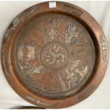 An Egyptian silver on copper plaque depicting deities, diameter 30cm and another Egyptian plaque