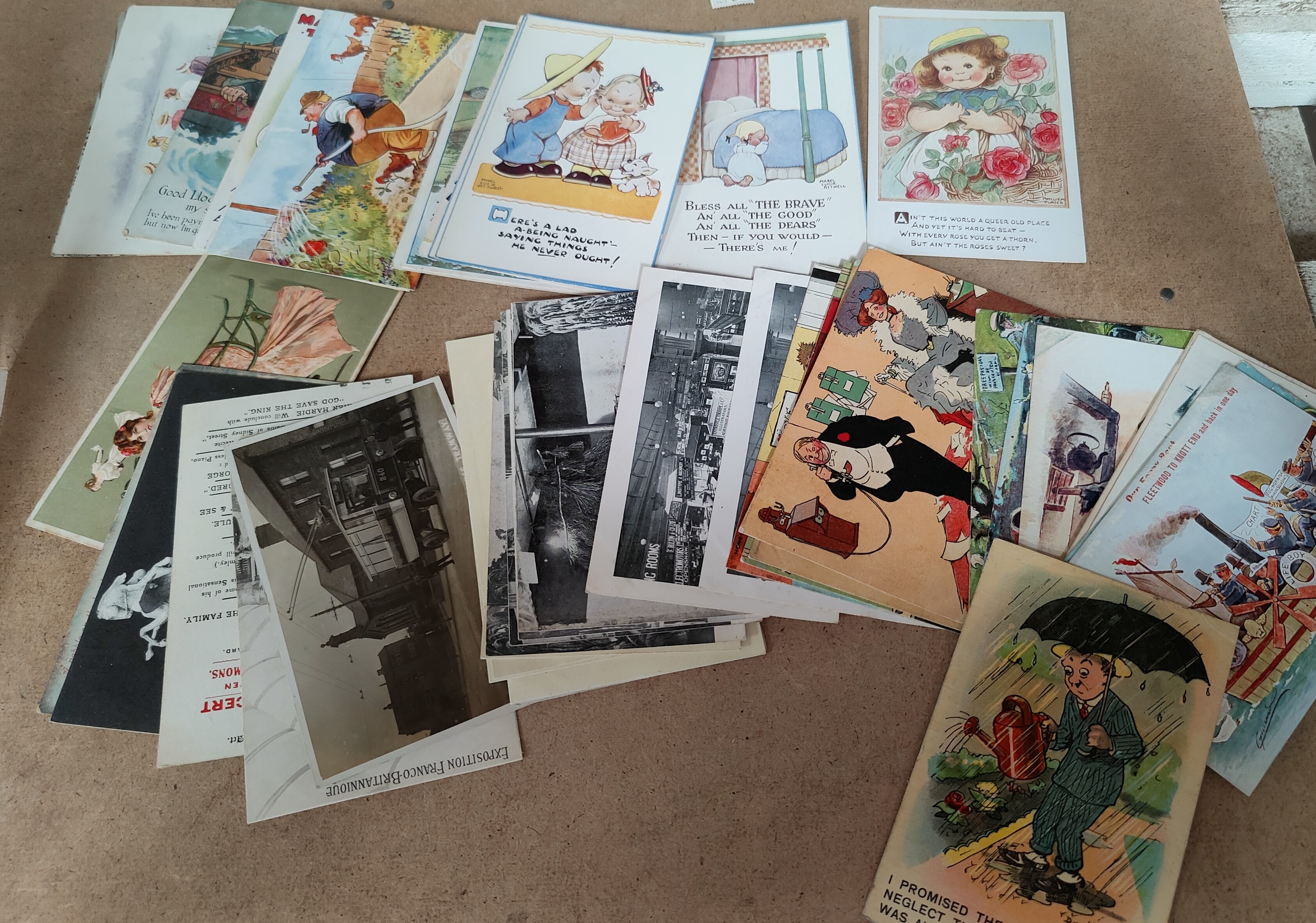 A collection of vintage humorous cards by TOM B Cynicus etc