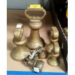 A graduating matched part set of butcher's bell weights