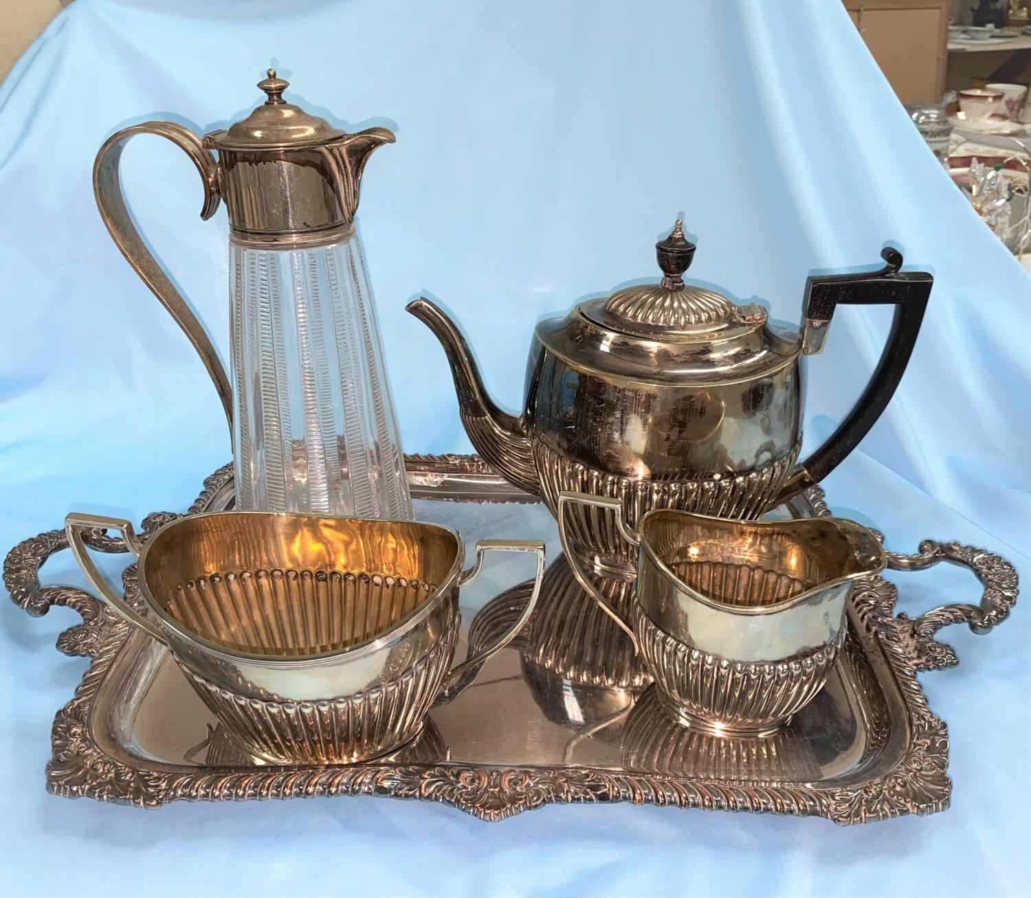 A cut glass claret jug with EPNS mount, a silverplate on copper tray and an EP 3 piece coffee