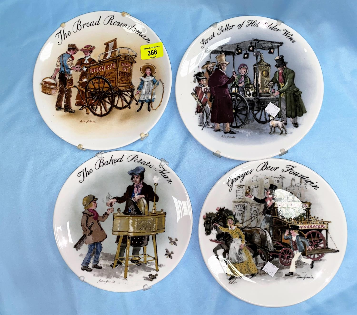 A Wedgwood set of 11 plates: Street Sellers of London; 2 others; a cut glass ship's decanter; a