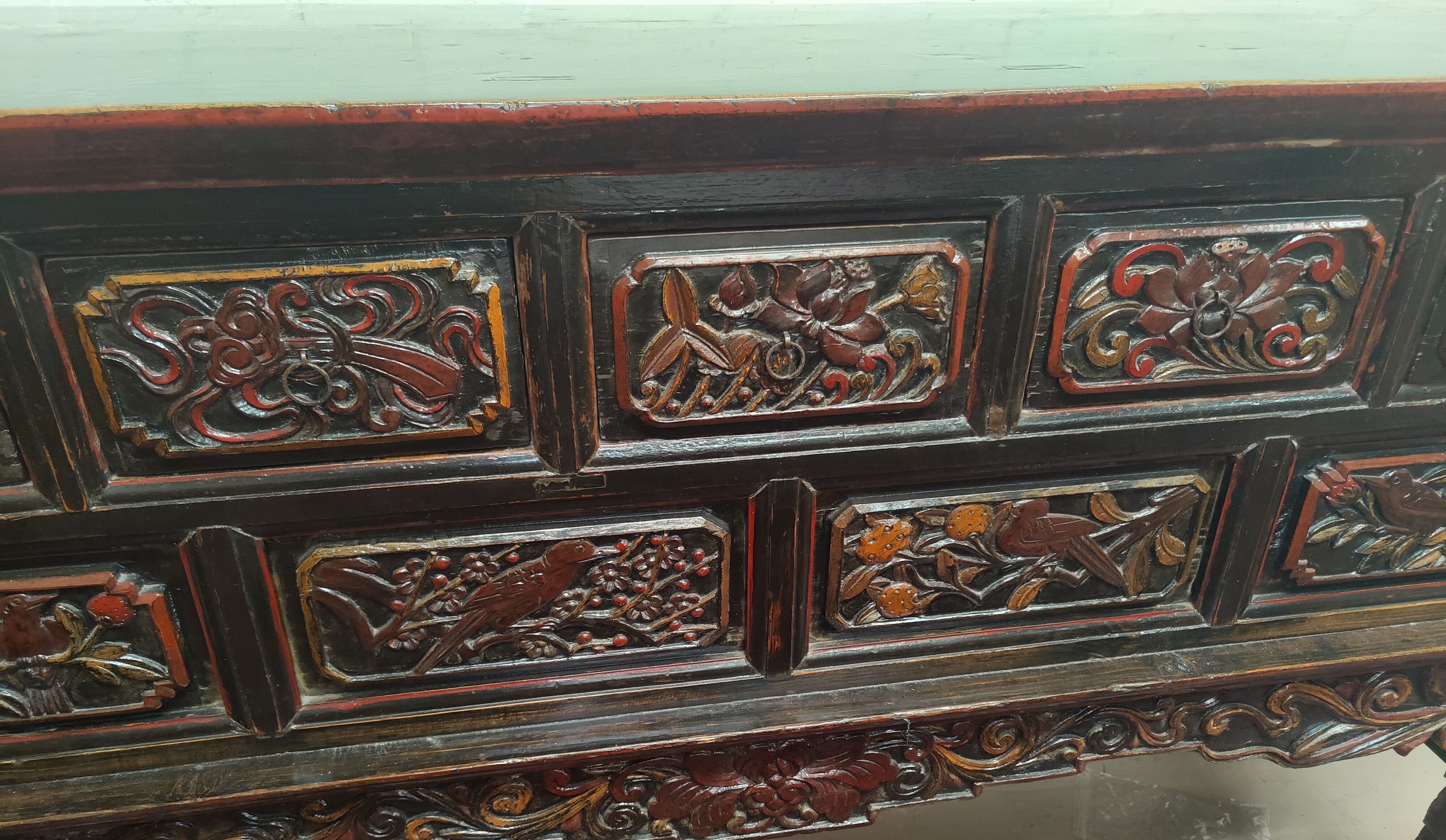 A late 19th/early 20th century Chinese unusual altar table, carved and lacquered with scroll end - Image 3 of 9