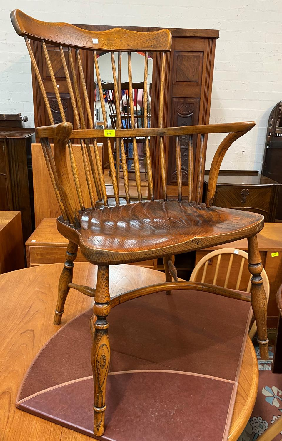 A reproduction distressed oak Windsor armchair with comb back
