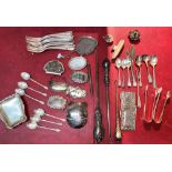 A mixed selection of silver plated and white metal items including button hooks, decanter labels etc