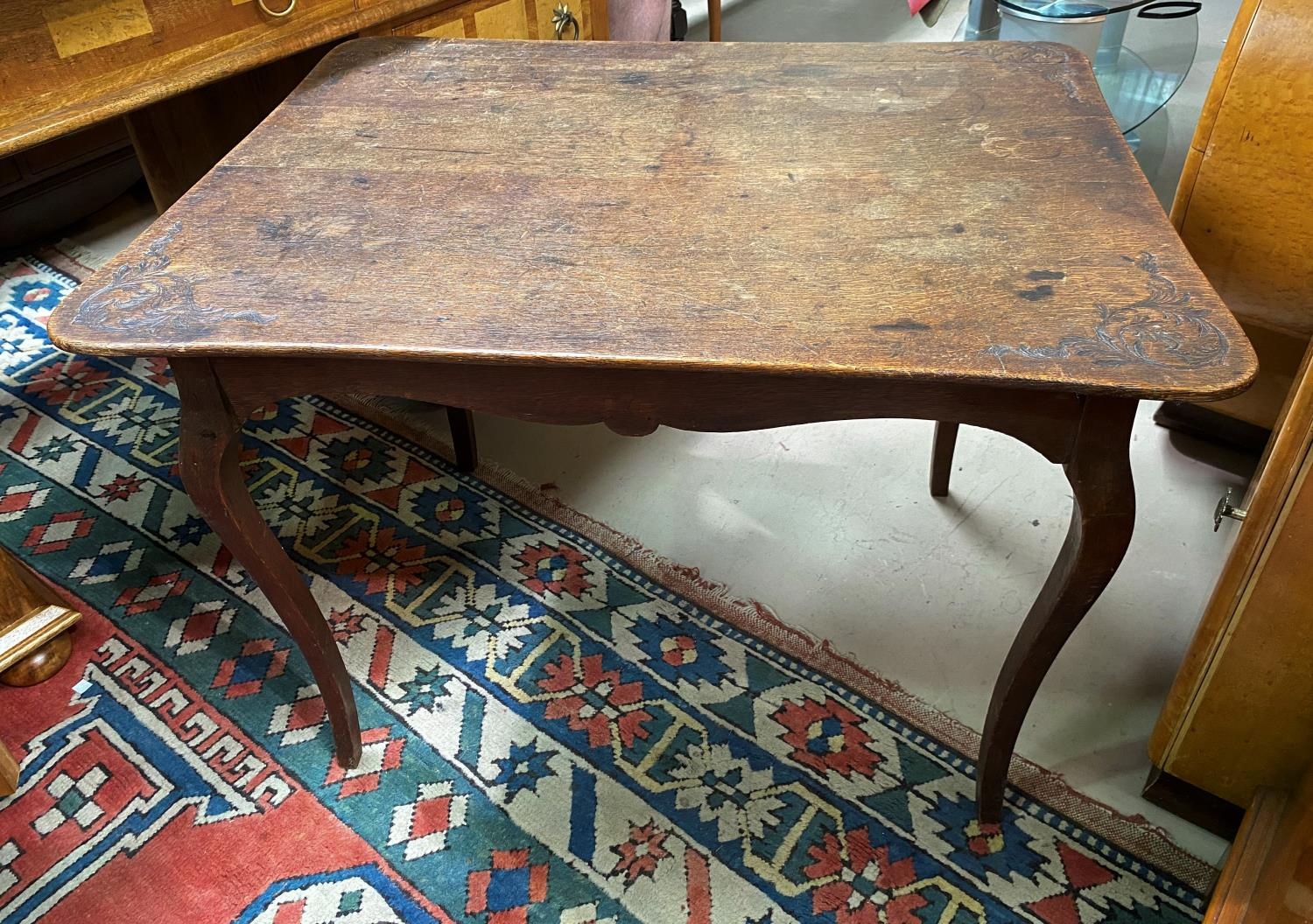 A mahogany side/writing table with rectangular top
