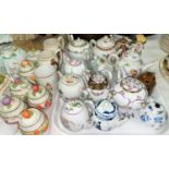 A selection of miniature teapots and decorative china